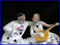 Pendulette Art déco et ses 2 vases Pierrot et Colombine, porcelaine Allemande